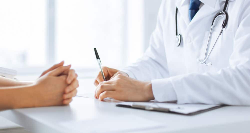 Patient and doctor taking notes - Tele Leaf
