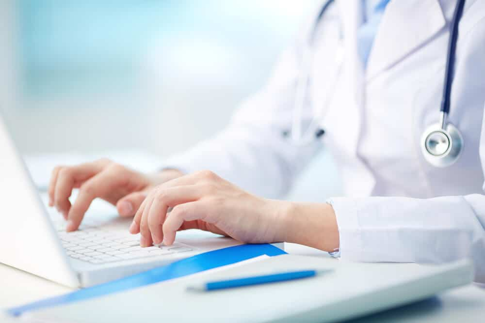 Medical person typing - Teleleaf